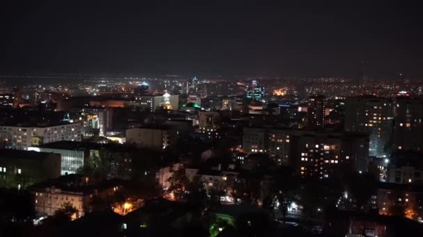 shooting from above. night city with lights Windows of houses in neighborhoods.