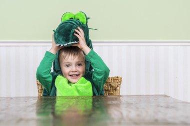 Beautiful child in crocodile costume