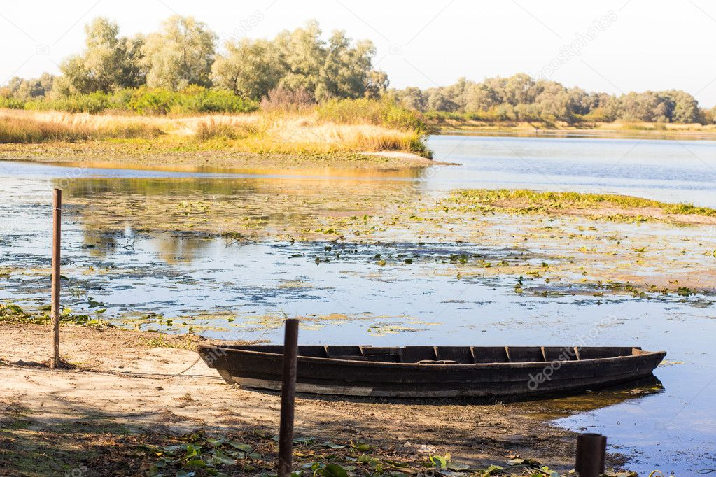 Фотообои vintage boat on river with picturesque river landscape