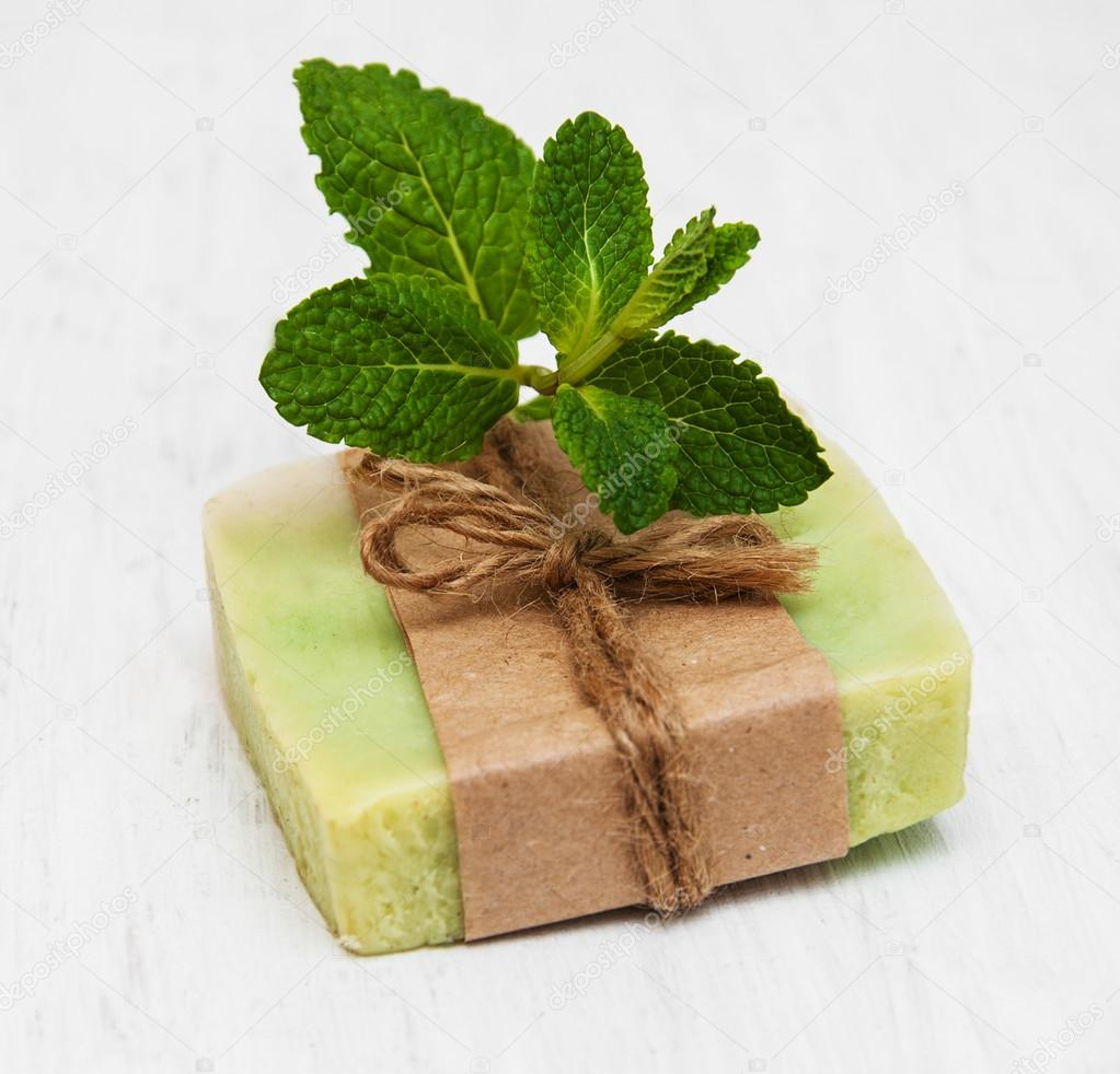 Homemade soap  with fresh mint leaves