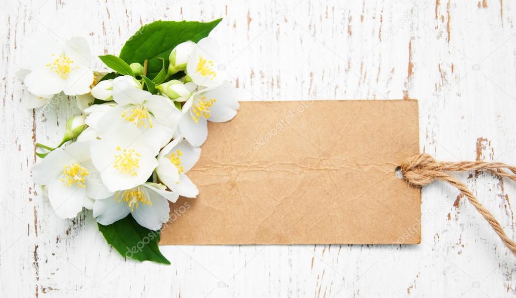 Jasmine flowers and vintage tag