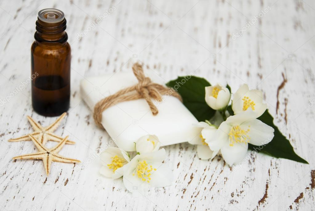 essential oil and soap with jasmine flower