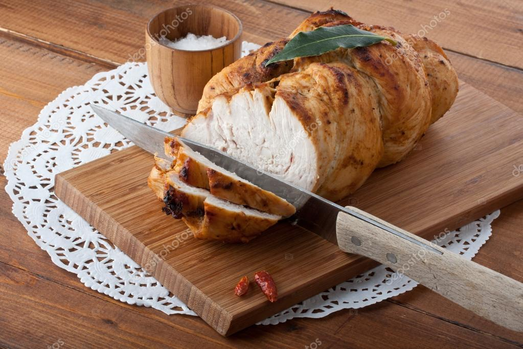 Roasted turkey breast on wooden plank