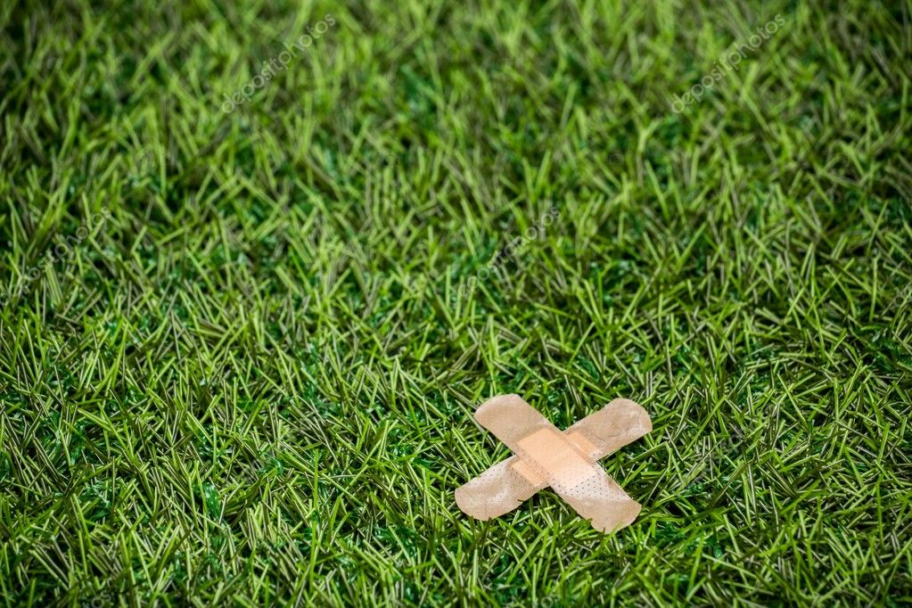 Adhesive plasters sticked to green grass
