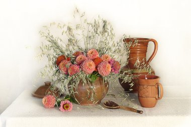 Still life with pink flowers and clay pots