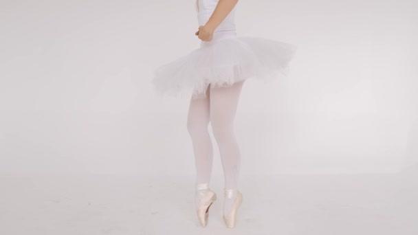 Woman dancing gracefully in ballet studio