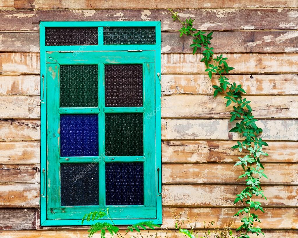 Green Frame Window Of The Old Rustic House On Background Wooden Walls Stock