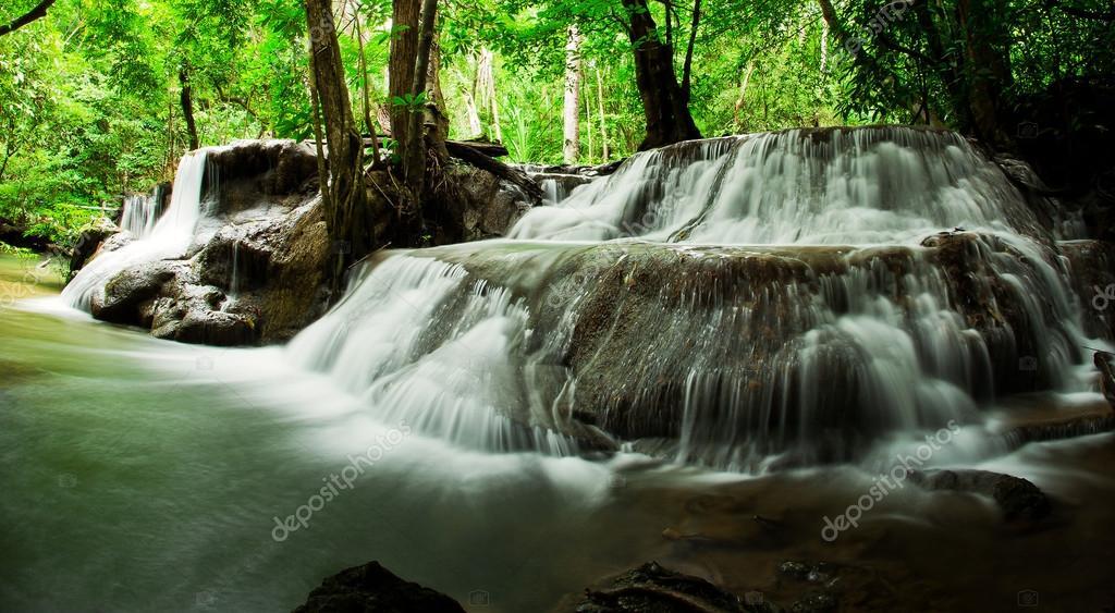 Waterfall in deep rain forest jungle. (Huay Mae Kamin Waterfall
