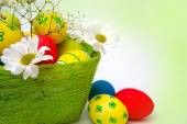 Easter eggs, baskets and flowers