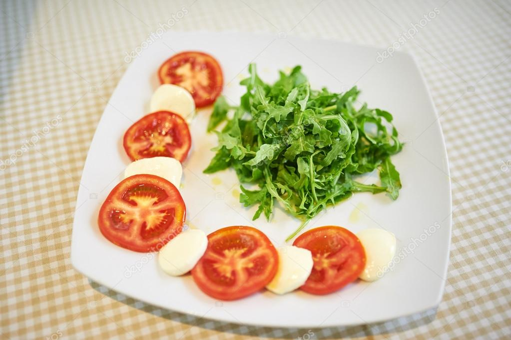 Tomato With Mozzarella With Arugula — Stock Photo ...