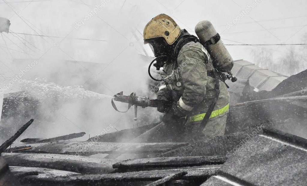 The firefighters extinguish the flame on fire