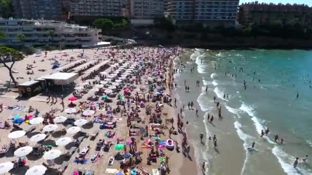 Spain, Salou city. Top aerial view of the city beach Salou. A lot of people on the beach. Summertime holidays by the sea. Traveling around Spain