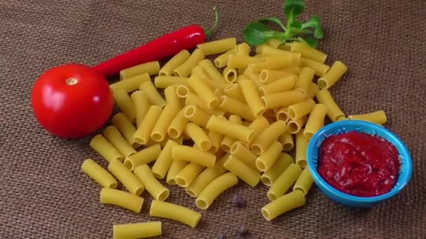 Raw yellow pasta, macaroni on sack background