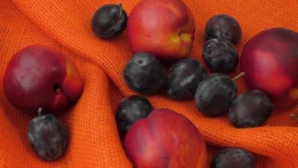 Peach nectarine isolated on orange background