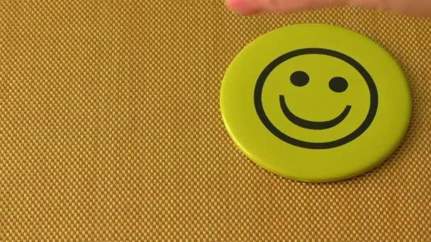Smajlíka. Symbol štěstí, úspěch, dobré náladě a životní spokojenosti