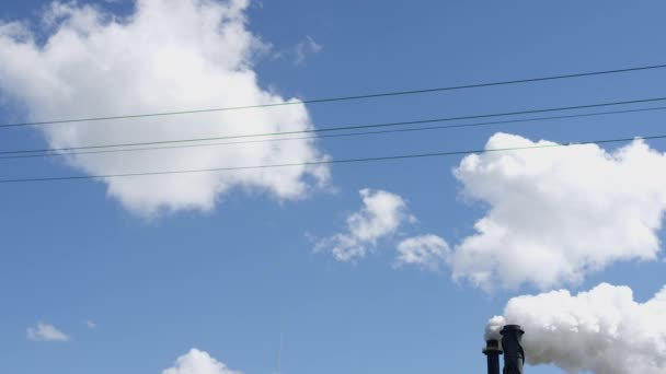 Industrial smokestack with smoke on blue sky background