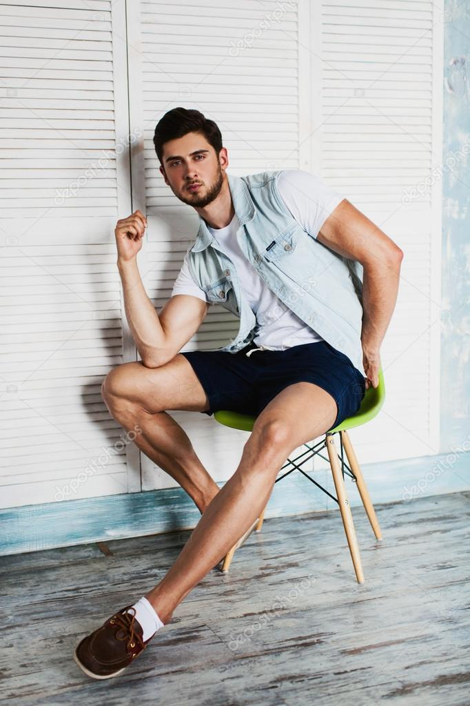 Trendy Man Sitting On Chair Stock Photo C Glediska 113946204