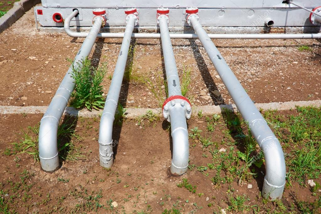 Oil pipelines from the pumping station belonging to the ground