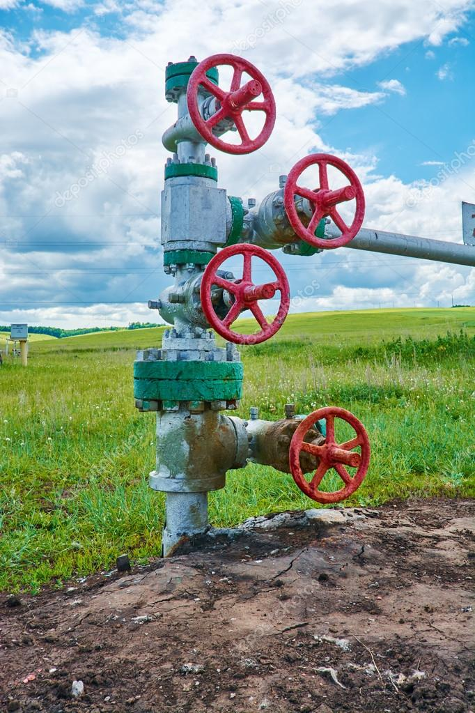 Valves on the pipeline at the mouth of the oil well