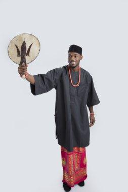 Man with fan in hand
