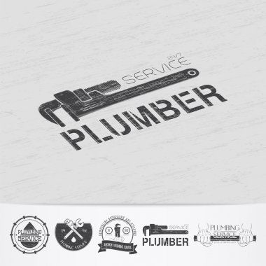 Plumbing service. Home repairs. Repair and maintenance of buildings.Old retro vintage grunge. Scratched, damaged, dirty effect. Monochrome typographic labels, stickers, logos and badges.