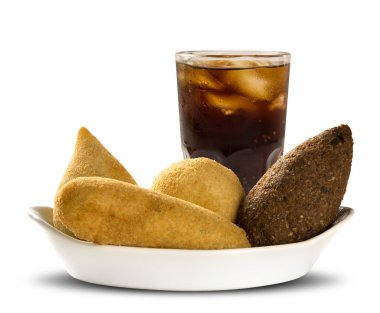 Mixed brazilian snack with cola on white background.