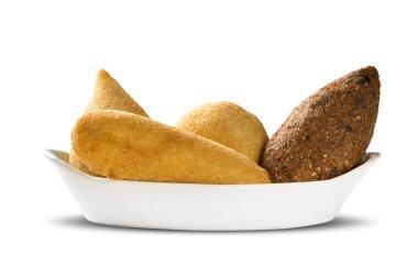 Mixed brazilian snack on white background.
