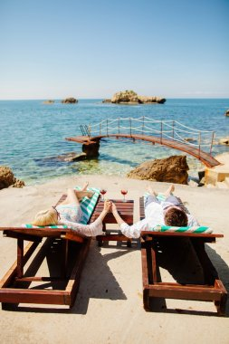 honeymoon couple relax on beach wth sea view