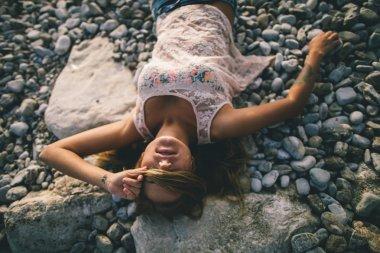 dreamy girl laying on beach