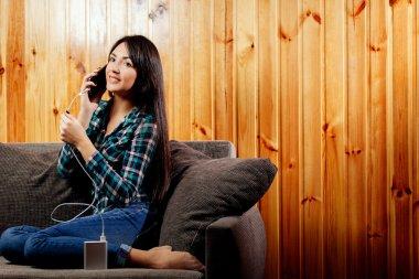 girl with powerbank charging smartphone