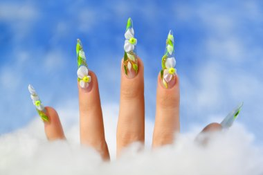 Acrylic flowers on women's nails.