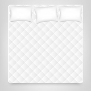 hree pillows on white mattress