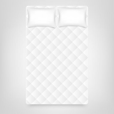 wo pillows on white mattress