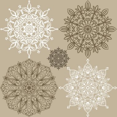 Set of round lace ornaments