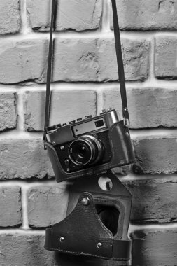Retro camera on a brick wall