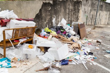 Outdoor rubbish dump potentially store stagnant water and breeding ground for mosquitoes