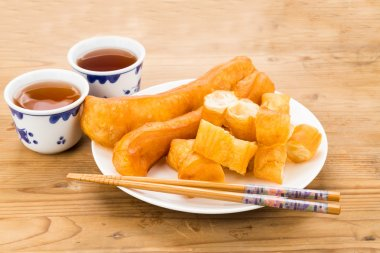 Fried bread stick or You Tiao served with Chinese tea.