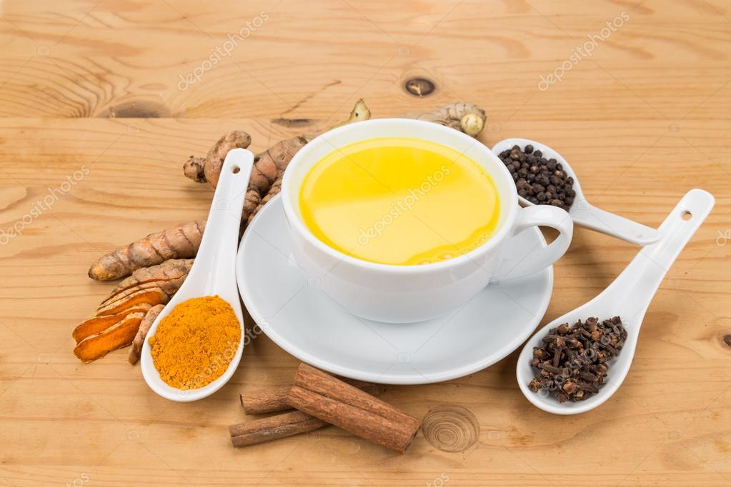 Healthy turmeric milk tea with ginger, cinnamon, cloves