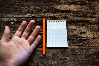 Man shows the problem lefties dirty hand after writing International Lefthanders Day