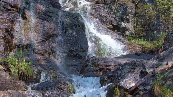 Waterfall flows down granite rocks