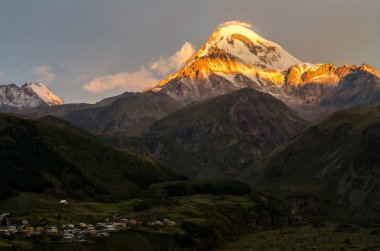 The top of Mount Kazbek in the rising sun