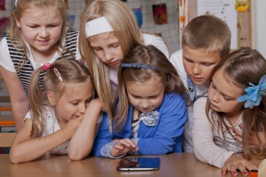 School kids playing with tablet pc