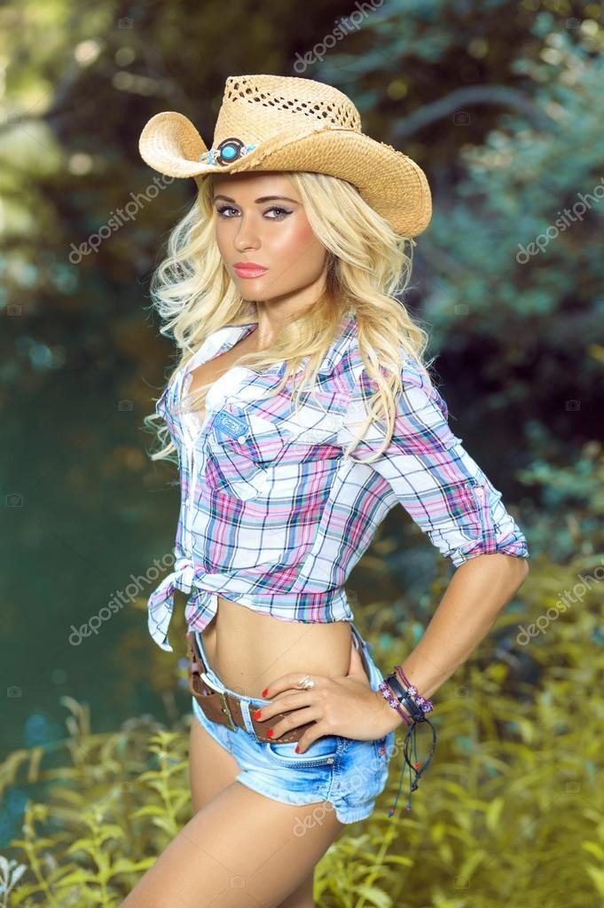 Girl in a cowboy hat. Sexy blonde. — Stock Photo © DarAnna  70614717 2c0963eb0ba