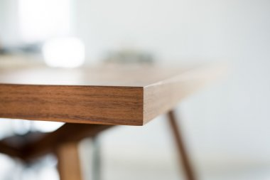 Abstract Dark brown wooden dining table edge