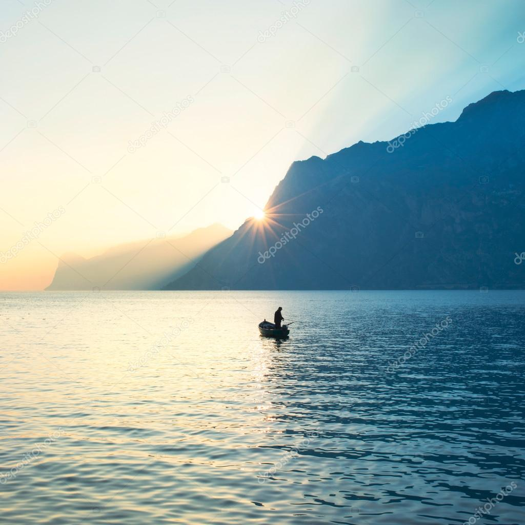 Fisherman fishing in the middle of the lake