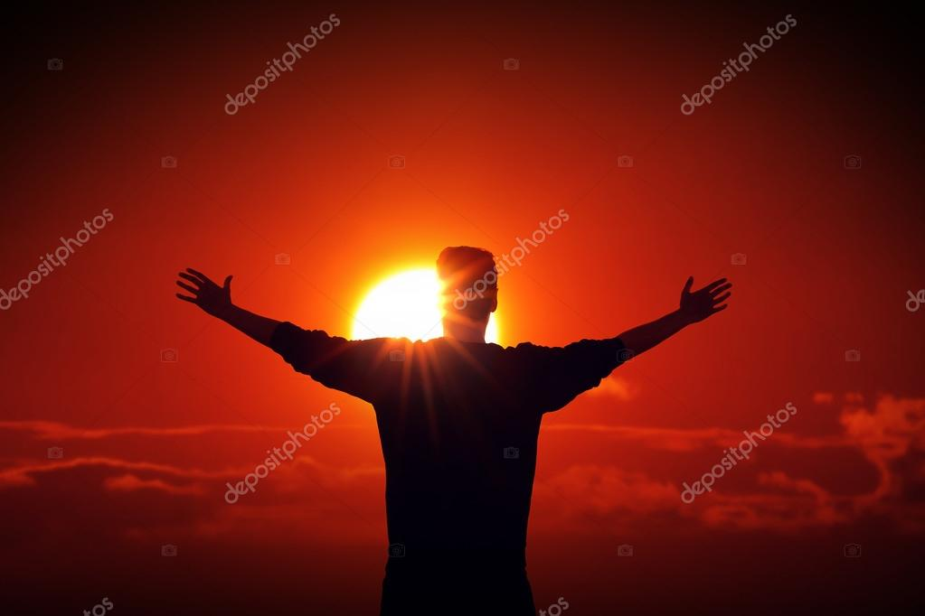 Man facing the sun finding power source