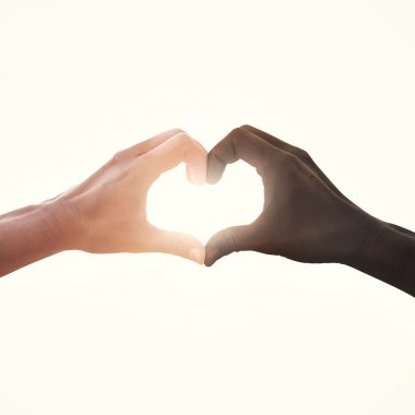 interracial couple in love heart shape hand gesture