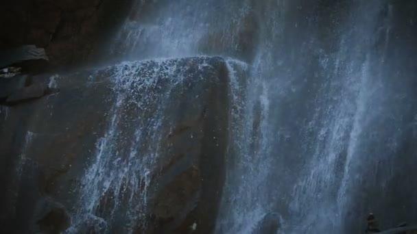 Mountain water flows down the cliffs