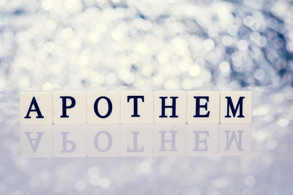 Parola di piastrelle con lettere scritta apotema u foto stock