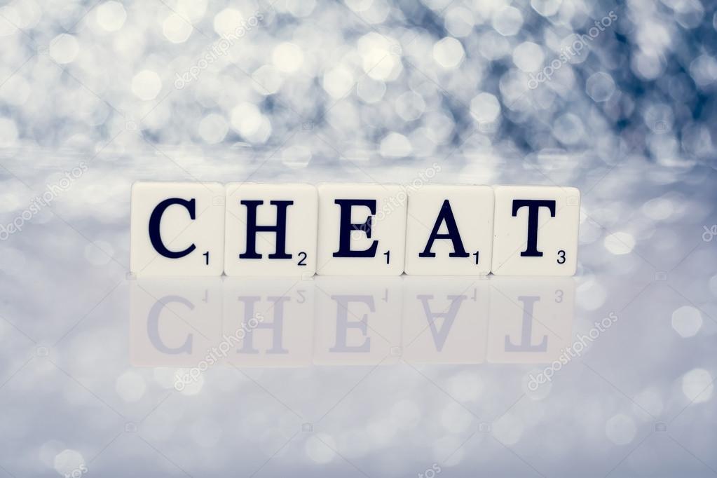Parola di piastrelle con lettere scritta cheat u foto stock